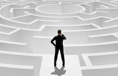 3d-rendering-3d-businessman-standing-front-maze