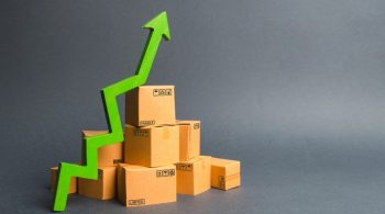 pile-cardboard-boxes-green-up-arrow-growth-rate-production-goods-products